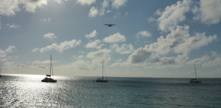 Plane coming in over Grand Case anchorage