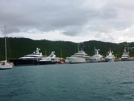 Superyachts lining the docks