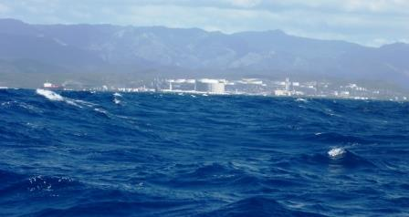 Huge oil facility behind the waves
